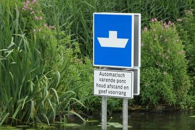 Dutch autonomous robotaxi ferry navigation sign.