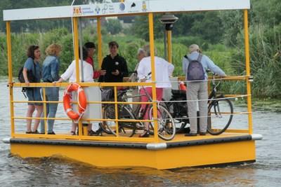 Autonomous robotaxi solar electric commercial ferry service boat carrying bicyclists.