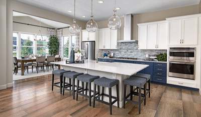 Richmond American's Decker floor plan showcases an open layout with a stunning kitchen and dining area.