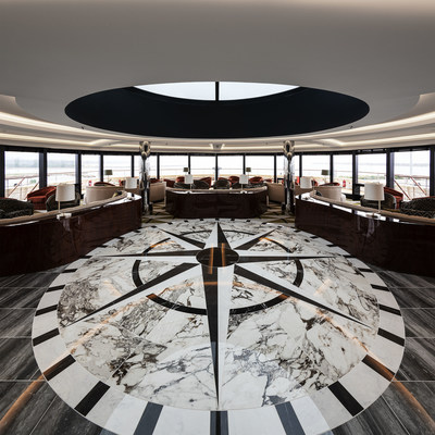 The Dome Lounge, one of two lounges aboard Atlas Ocean Voyages' World Navigator that features lively entertainment and offers spectacular 270 degree panoramic vistas.